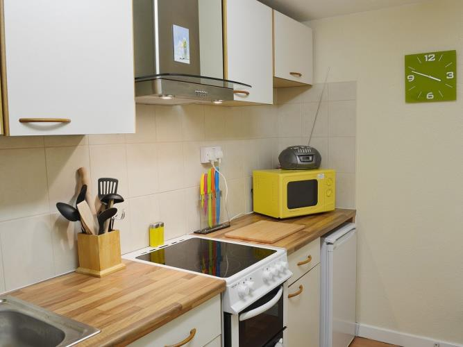well equipped kitchen with washing machine, microwave, oven and hob,fridge freezer etc.